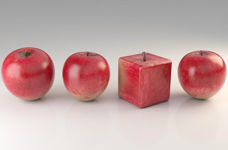 Vier rote Äpfel, einer hat die quadratische Form eines Würfels